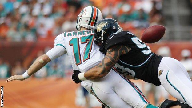 Jacksonville defence forces Miami Dolphins quarterback Ryan Tannehill to fumble
