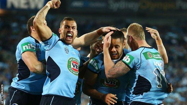 New South Wales celebrate scoring against Queensland