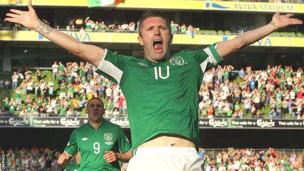 Robbie Keane celebrates his early goal against the Faroe Islands