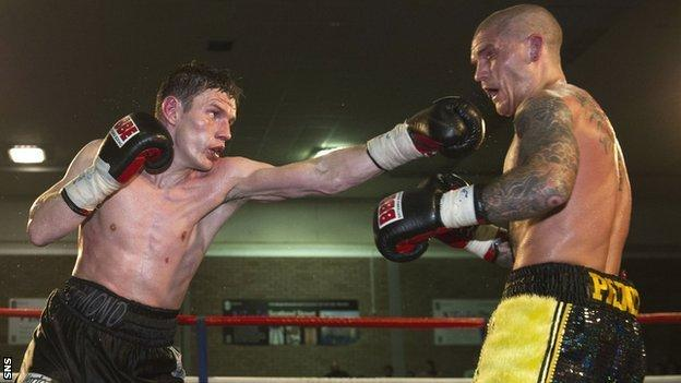 The defending champion Willie Limond throws a punch at Mitch Prince