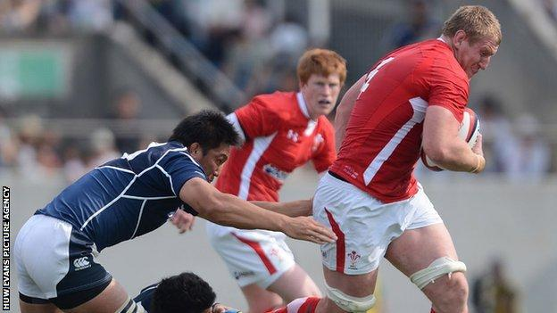 Bradley Davies bursts through a tackle for Wales in Osaka