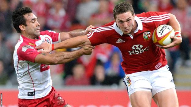 Wing George North attempts to break free from the defence during the Lions' 22-12 victory over Queensland Reds in Brisbane.