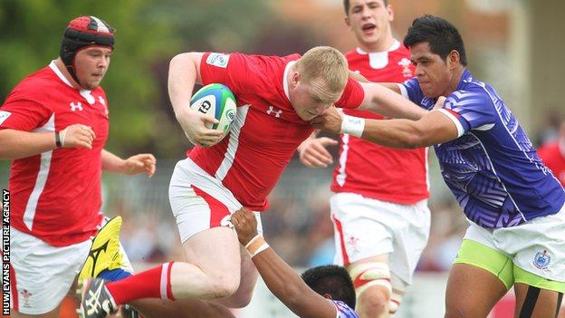 Wales' Ethan Lewis drives through the Samoan defence during their opening win