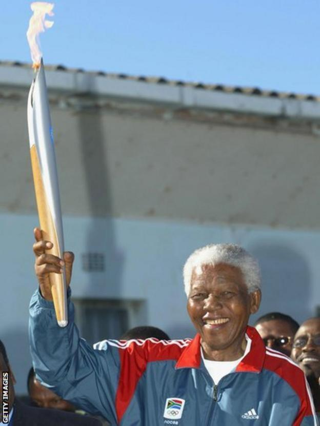 Nelson Mandela with Olympic torch