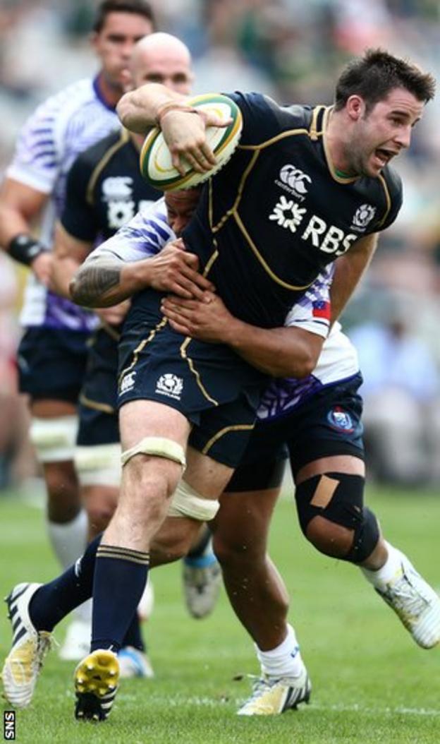 Johnnie Beattie is held up against Samoa