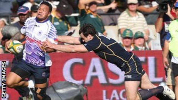 James Sooialo of Samoa dodges a Scottish tackle