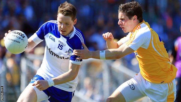 Conor McManus tries to get away from Kevin O'Boyle at Casement Park