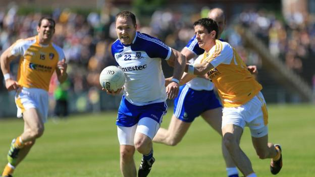Vincent Corey secures possession for Monaghan as Antrim's Sean Kelly tries to halt his progress