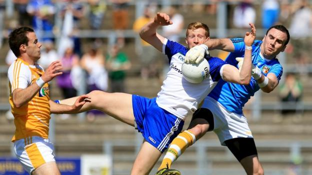 Antrim goalkeeper Chris Kerr attempts to collect the ball as Kieran Hughes challenges for Monaghan