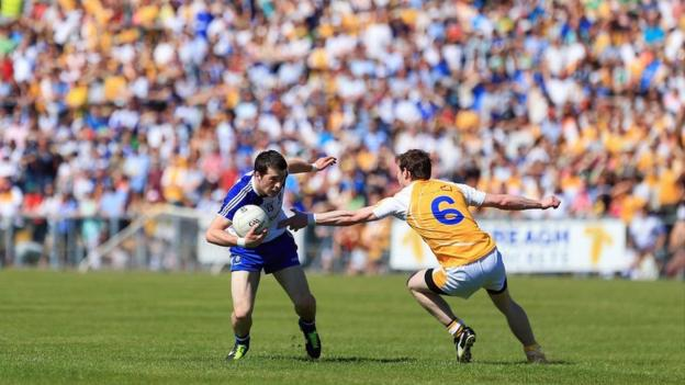 Christopher McGuinness prepares to take on Antrim's Justin Crozier as Monaghan book a semi-final against Fermanagh or Cavan