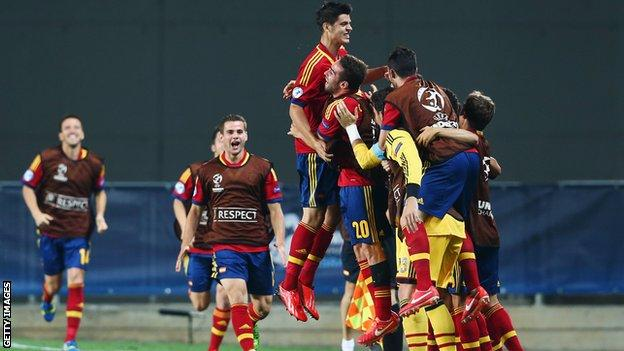 Spain's players celebrate after taking the lead against Germany at the European Under-21 Championship