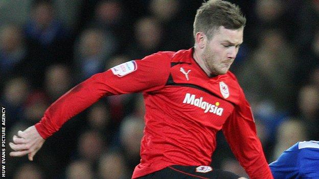 Aron Gunnarsson in action for Cardiff City
