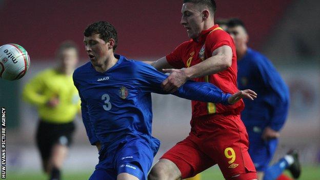 Wales U21 striker Jake Cassidy in action against Moldova