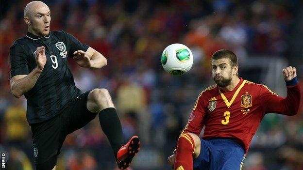 Conor Sammon and Gerard Pique
