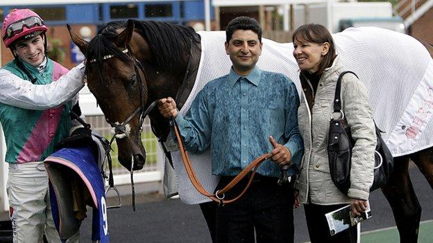 Jockey James Doyle (left), with stable hand and Lady Cecil