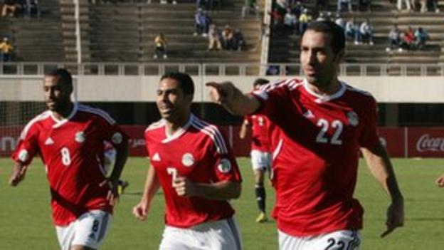 Egyptian players celebrate during their victory against Zimbabwe