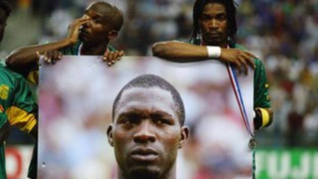 Samuel Eto'o and Rigobert Song struggle with their emotions as a medal is place on an image of Foe