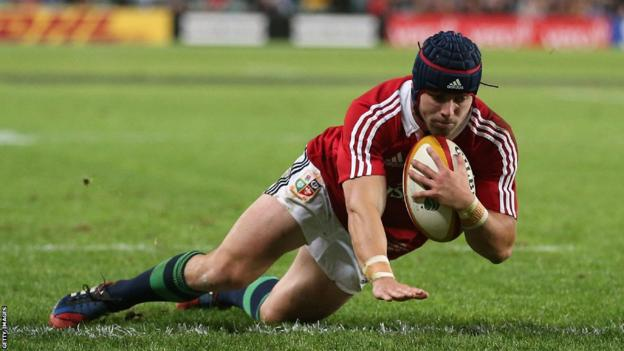 Lions full-back Leigh Halfpenny goes over for a try after Jonny Sexton had scored their first against the Waratahs