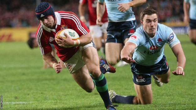 Leigh Halfpenny scores his second try and the full-back also lands eight kicks to finish with 30 points against the Waratahs - a new individual Lions record in Australia