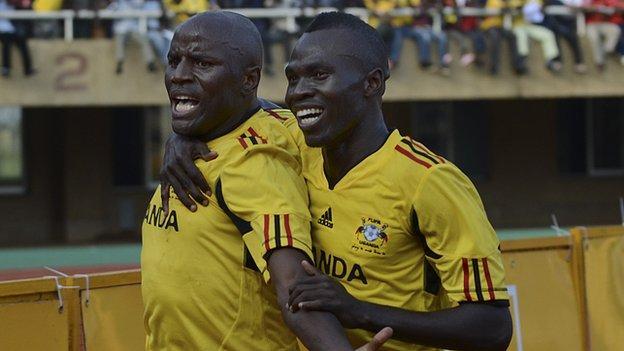 Uganda's Godfrey Massa and Emmanuel Okwi (left)