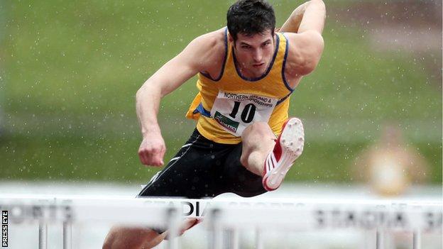 Ben Reynolds on his way to winning the 110m hurdles