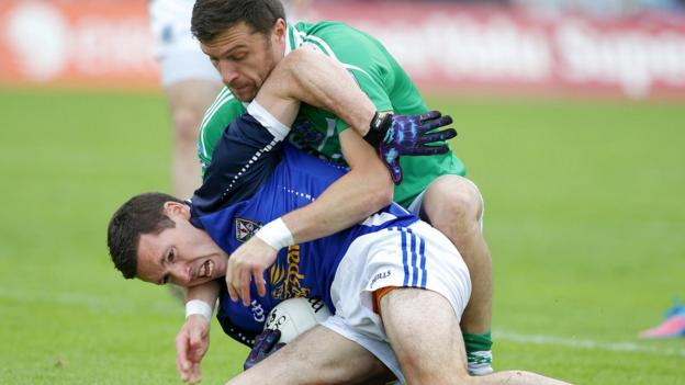 Ronan Flanagan is determined to hold onto the ball despite the close presence of Fermanagh defender Ryan McCluskey