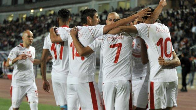 Tunisia players celebrate a goal by Oussama Darragi