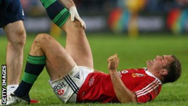 Jamie Roberts is treated after injuring his leg against New South Wales