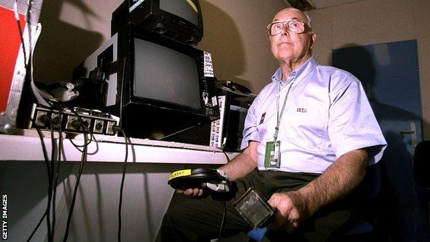 Murray Walker pictured while commentating for the BBC