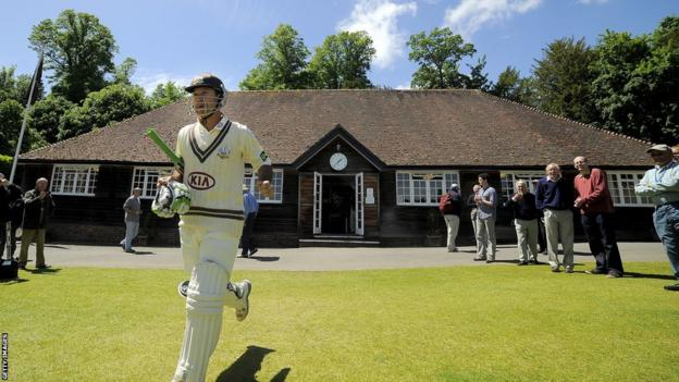 Ricky Ponting walks out of the pavilion for Surrey