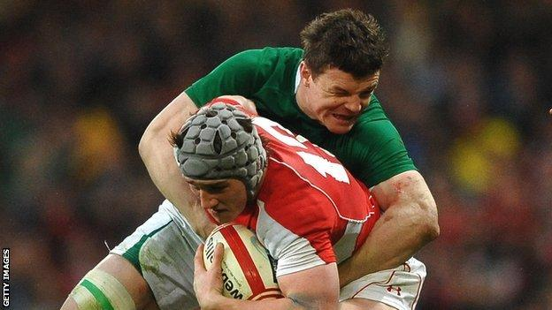 Ireland's Brian O'Driscoll tackles Wales centre Jon Davies in the 2013 Six Nations