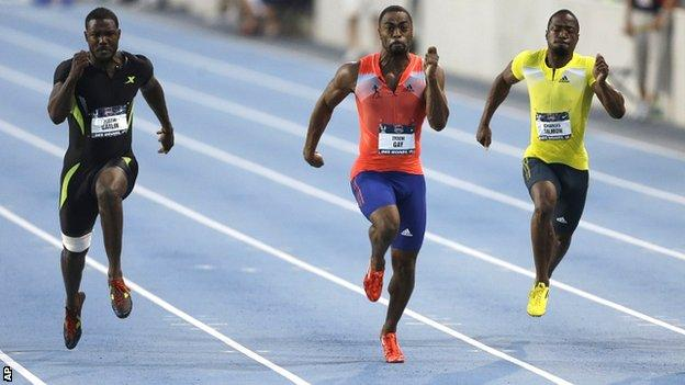 Tyson Gay (centre) races to victory in Iowa