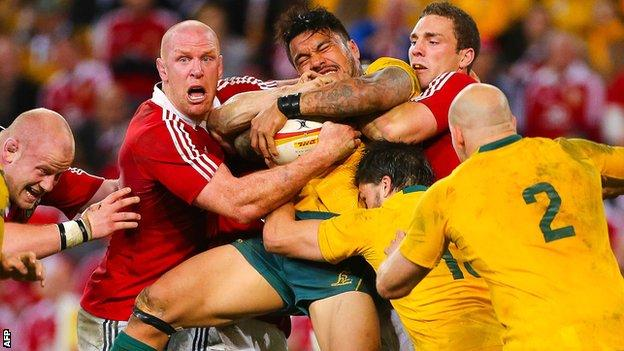 Lions Paul O'Connell (second left) and George North (second righty) get to grips with Wallaby wing Digby Ioane