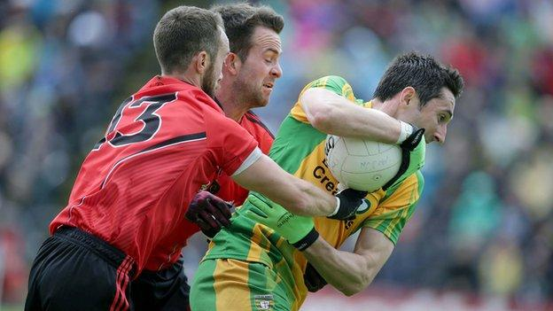 Donegal's Rory Kavanagh with Conor Laverty and Mark Poland of Down