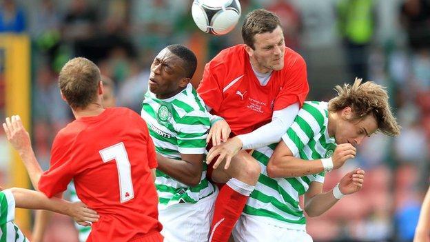 Cliftonville's Diarmuid O'Carroll gets above Celtic pair Darnell Fisher and Patrik Twardzik in last summer's friendly