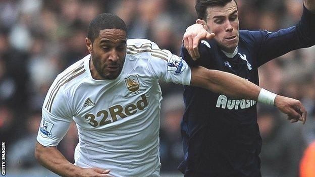 Swansea's Ashley Williams takes on Gareth Bale of Tottenham Hotspur