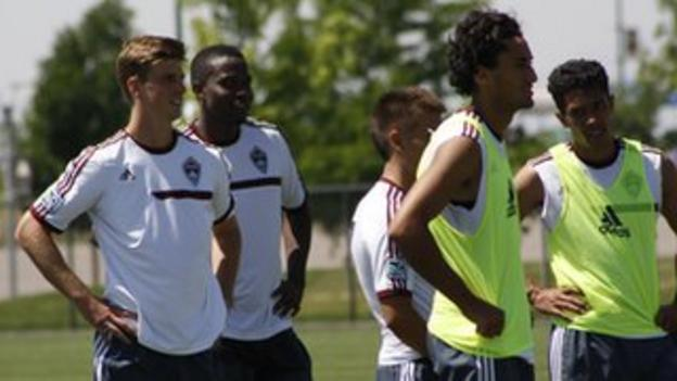 Danny Mwanga (second from left) smiles during a training session for the Rapids