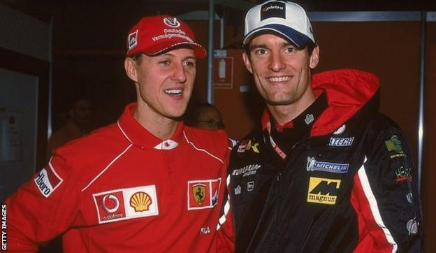 Mark Webber (right) with Michael Schumacher
