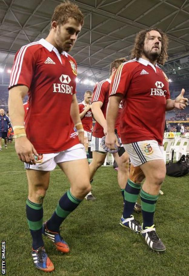Halfpenny and fellow Welsh international Adam Jones look dejected as they leave the Etihad Stadium pitch.