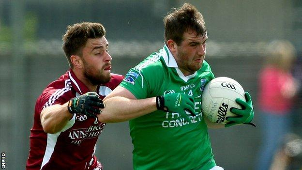 Westmeath's Paul Sharry challenges Fermanagh's Sean Quigley