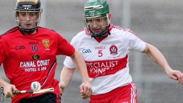 Derry's Ruairi McCloskey in action against Scott Nicholson of Down