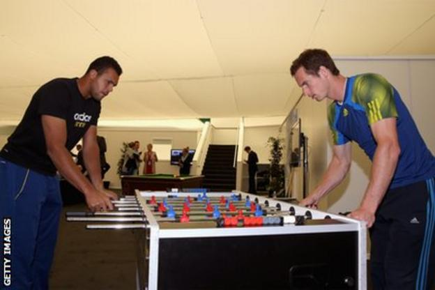 Andy Murray (right) enjoys a game of table football with Jo-Wilfried Tsonga