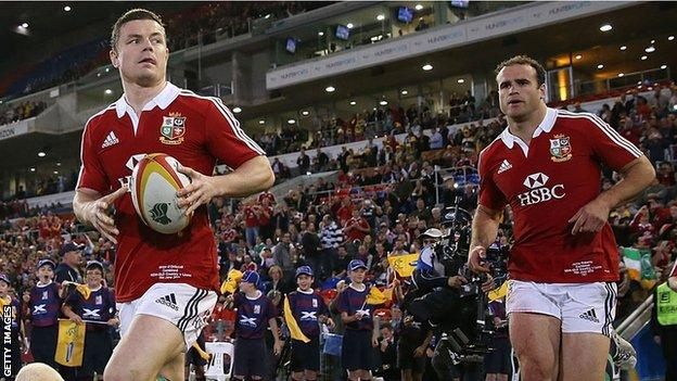 Brian O'Driscoll and Jamie Roberts run onto the field for the Lions against the Waratahs