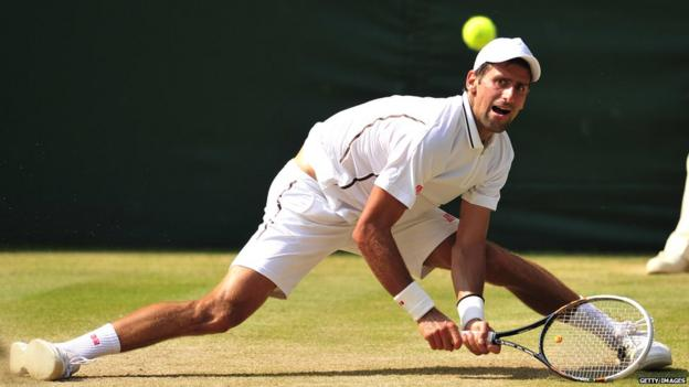 Novak Djokovic slips as he tries to retrieve an Andy Murray shot