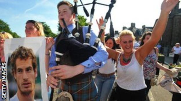 A piper leads scenes of celebration as they spill on to the streets of Dunblane