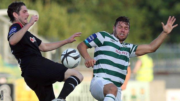 Ruaidhri Higgins battles with James Chambers in Tallaght