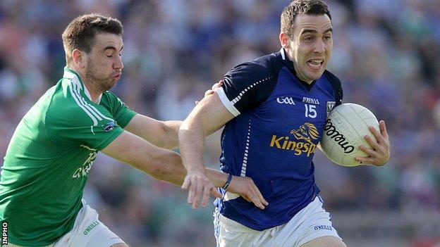 Fermanagh's Brian Cox tackles Cavan forward Eugene Keating