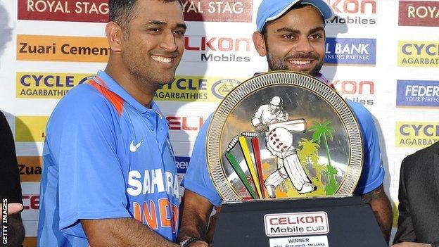 India's Mahendra Dhoni and Virat Kohli with the tri-series trophy