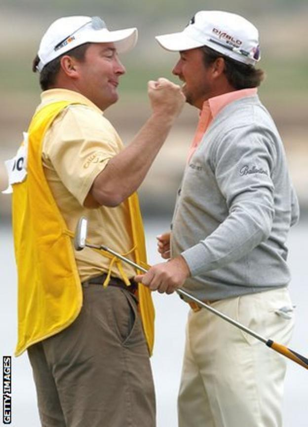 Ken Comboy and Graeme McDowell celebrate after the US Open success