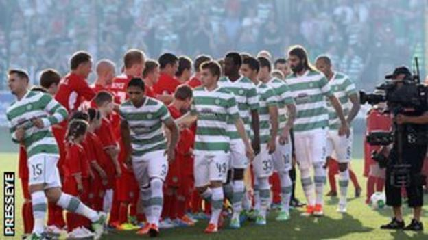 Cliftonville and Celtic players shake hands before the game